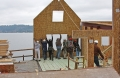 Bass Cove Zero Energy House Tipping SIPs into Place (Washington, USA)